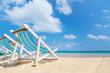 canvas beach bed on the beach with nice sky and cloud