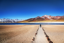 Tourist Enjoying The Beautiful Landscape Of Atacama Desert In Chile. Winter Time.