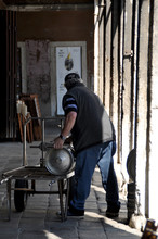 Man Unloading Beer Barrels