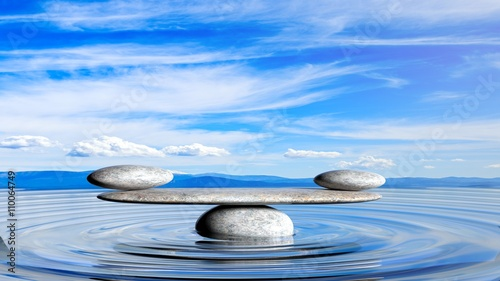 Akustikstoff - 3D rendering of balancing Zen stones in water with blue sky and peaceful landscape.