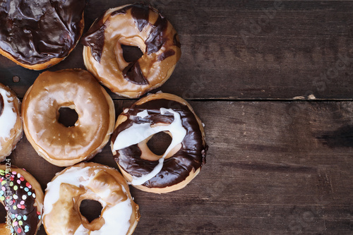 Photo  Donut Over Rustic Barn Wood Background