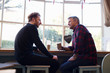 canvas print picture -  Two Male Friends Meeting In Coffee Shop