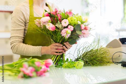 Fototapeta close up of woman making bunch at flower shop obraz na płótnie