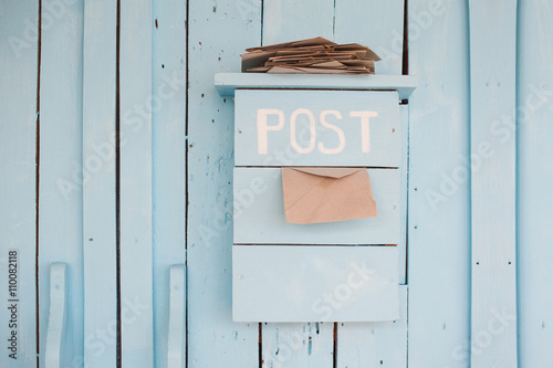 Fotografie, Obraz  mailbox with letters in vintage style on wooden blue background