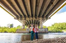 Boy And Girl Standing Under The Bridge