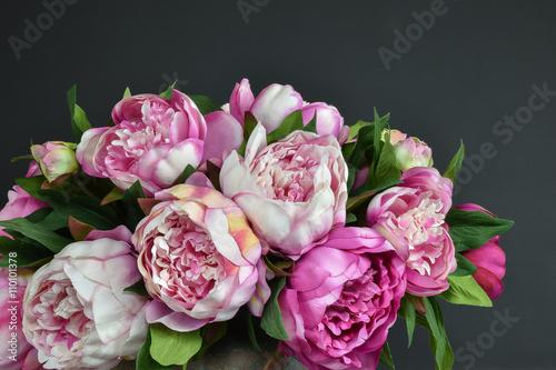 Pink bouquet peony flowers. Dark background.