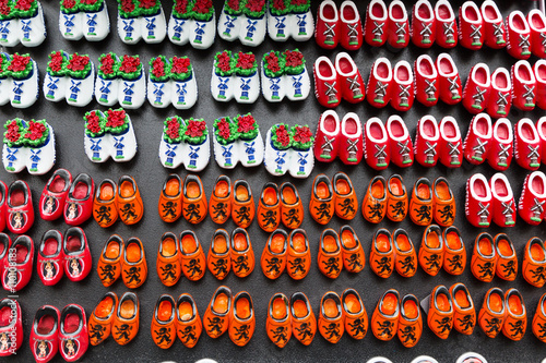 Photo  Magnets with dutch traditional wooden shoes or clogs for sale in shop in Netherl