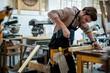Leinwandbild Motiv Carpenter working on his craft