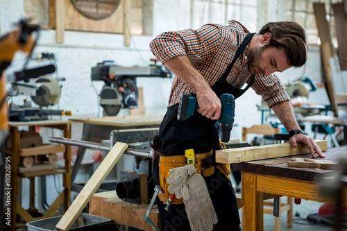Foto  Carpenter working on his craft