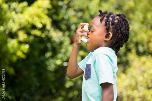 Boy using an asthma inhaler Canvas Print