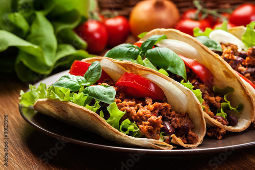 Fényképezés  Mexican tacos with minced meat, beans and spices