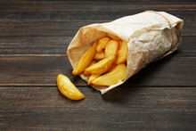 Tasty Potato Wedges Wrapped For Takeaway At Wood