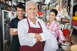 Leinwanddruck Bild - Confident Salespeople In Cheese Shop