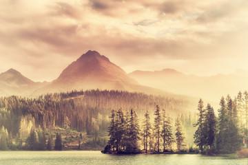 FototapetaVintage Sunset over a Lake in Mountains