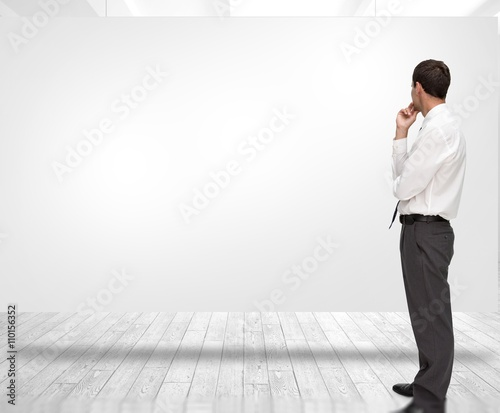 Fotografía  Composite image of thoughtful classy businessman looking away