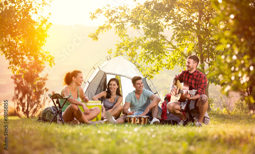 Tuinposter Kamperen young friends have good time on camping trip