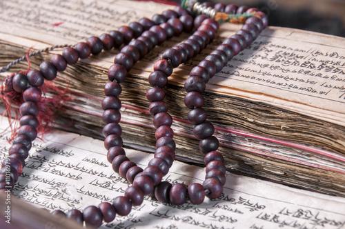Buddhist religious japa mala on manuscript