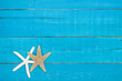 Blank rustic sign with two starfish