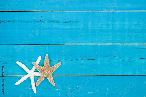Fotografie, Obraz  Blank rustic sign with two starfish