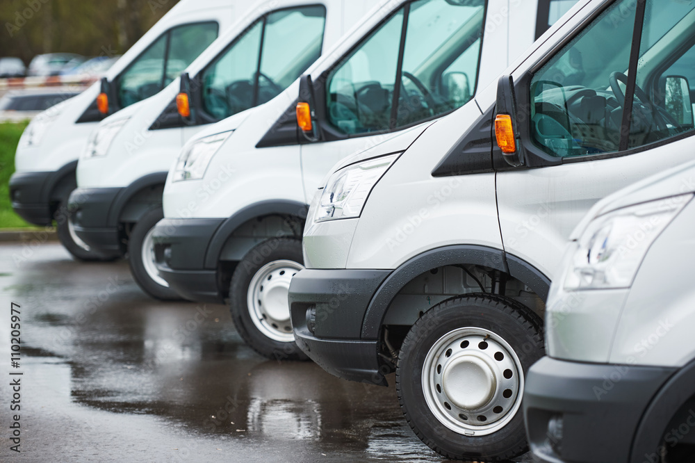Fototapeta transporting service company. commercial delivery vans in row