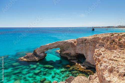 Foto op Canvas Cyprus Beautiful natural rock arch near of Ayia Napa, Cavo Greco and Protaras on Cyprus island, Mediterranean Sea. Legendary bridge lovers. Amazing blue green sea and sunny day.