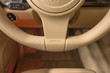 Luxury car interior detail. Airbag sign on steering wheel.