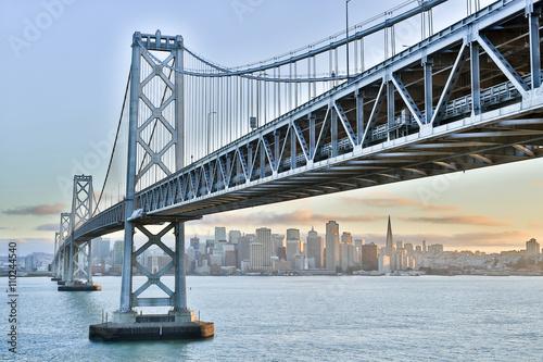 Keuken foto achterwand Bruggen Sunset over San Francisco-Oakland Bay Bridge and San Francisco Skyline. Yerba Buena Island, San Francisco, California, USA.