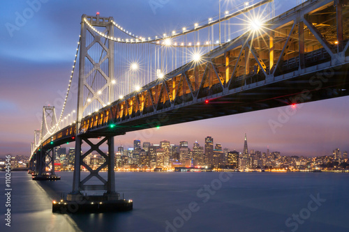 Fotobehang San Francisco Dusk over San Francisco-Oakland Bay Bridge and San Francisco Skyline, California, USA.