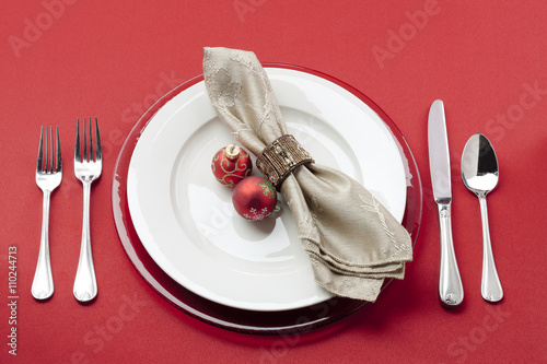 Photo  image of a a table with plate, fork, table cloth and christmas bulb