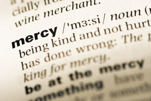 Close Up Of Old English Dictionary Page With Word Mercy