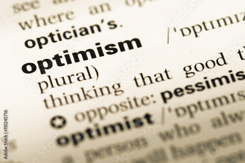 Fotografia  Close up of old English dictionary page with word optimism