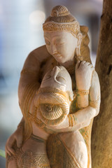 Fototapeta Erotyka Closeup of Khmer wooden statues of lovers with blurred backgroun