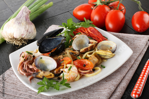 Fotografering  Italian pasta with seafood, mussels, clams, shrimp and squid