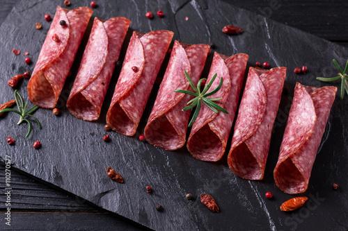 Fototapeta Delicious salami with basil and wine, selective focus obraz