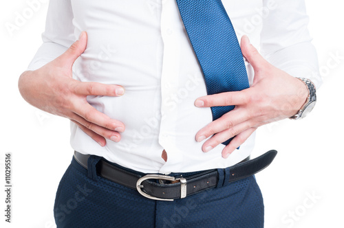 Photo Businessman in closeup holds his stomach because of bloating