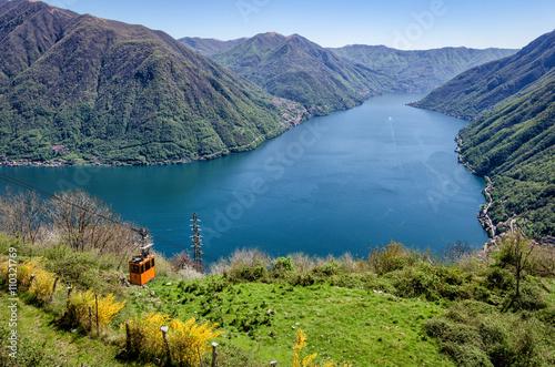 Photo Lago di Como (Lake Como) scenic view with cable car between Argegno and Pigra