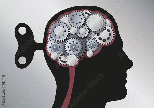 Fotografie, Obraz  Concept de la manipulation intellectuelle avec une tête d'homme vue de profil avec une clé à l'arrière du crâne symbolisant l'emprise sur le cerveau mécanique, fait d'engrenages