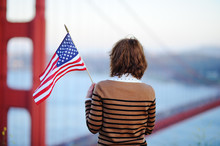 Young Woman Looking On Famous Golden Gate Bridge