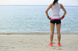 young fitness woman runner on seaside beach