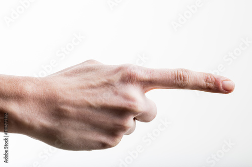 Photo female hand pointing her index finger out