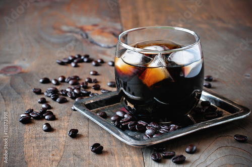 Kahlua liqueur in glasses with coffee beans on a wooden background, selective fo Poster