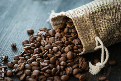Roasted coffee beans on old wooden table