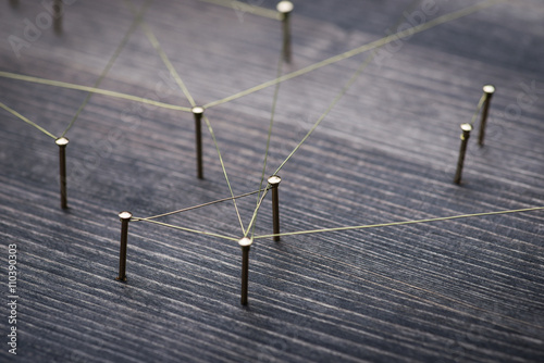 Fotografia  Web of wires, showing connections between groups and singles