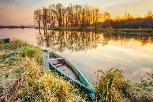 Fotobehang Zwavel geel Lake, River And Old Wooden Blue Rowing Fishing Boat At Beautiful