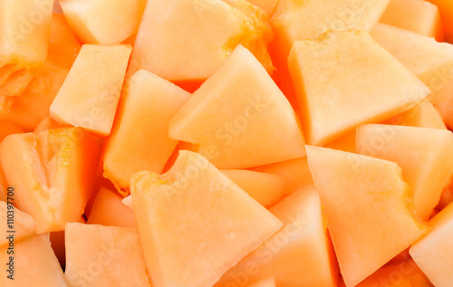 cantaloupe malons slices on white plate on white background