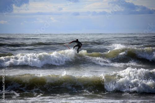 Toscana,Lucca,mare a Viareggio e uomo che fa surf. #110428340