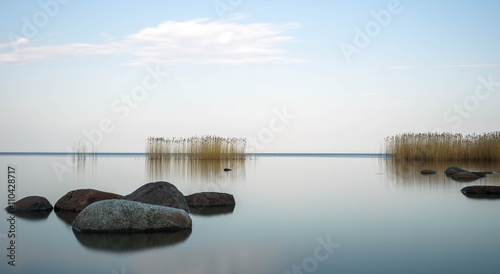 Fotografia, Obraz  the blue sky is reflected Ladoga lake in evening