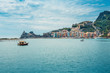 Maritime Italian boat trip. On the horizon Portovenere city with lighthouse, hiding in the mountains . Cinque Terre region Italy