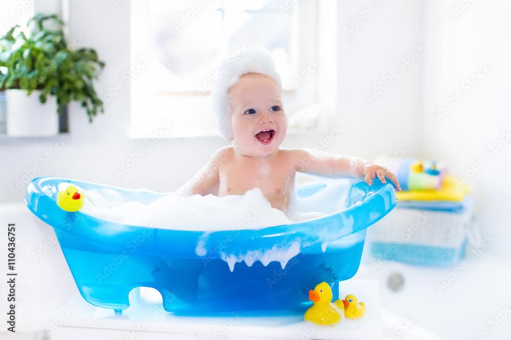 Fototapeta Little baby taking a bath
