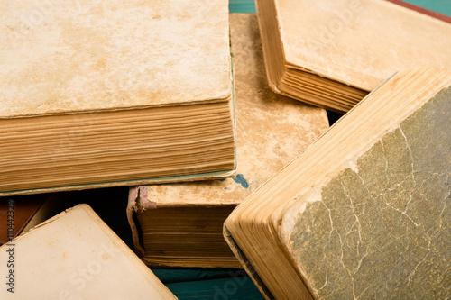 Fototapeta Scattered old and used hardback books or text books obraz na płótnie
